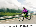 young woman cycling | Shutterstock . vector #555469123