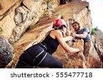 young climbers rock climbing | Shutterstock . vector #555477718