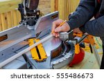 man cutting wood on electric... | Shutterstock . vector #555486673