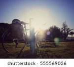 vintage bicycle in the park... | Shutterstock . vector #555569026