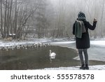 A Young Woman Feeding On A Lak...