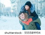 young couple resting in park ... | Shutterstock . vector #555589954