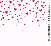 pink and red hearts confetti... | Shutterstock .eps vector #555616330