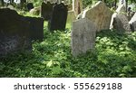 Small photo of PRAGUE, CZECH REPUBLIC - APRIL 24, 2014: Tombstones on Old Jewish Cemetery in the Jewish Quarter in Prague.There are about 12000 tombstones presently visible