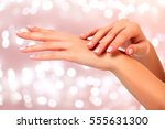 beautiful woman hands against... | Shutterstock . vector #555631300