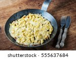 spaetzle with melted cheese in...   Shutterstock . vector #555637684