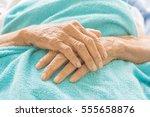old hand women on bed patient | Shutterstock . vector #555658876