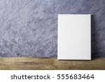 blank canvas frame on old wood...   Shutterstock . vector #555683464