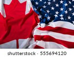 american and canadian flags... | Shutterstock . vector #555694120