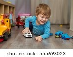 little boy plays with toy car... | Shutterstock . vector #555698023