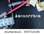 Small photo of Amenorrhea word, medical term word with medical concepts in blackboard and medical equipment.
