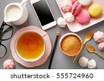 tea in pink cup flat lay on...   Shutterstock . vector #555724960