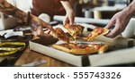 pizza sharing togetherness... | Shutterstock . vector #555743326