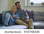 couple watching tv and eating