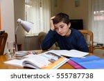 young boy doing homework for... | Shutterstock . vector #555787738