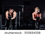 sporty couple exercising at the ... | Shutterstock . vector #555834358