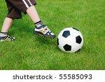 a boy kicking a soccer ball . | Shutterstock . vector #55585093