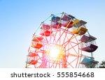 ferris wheel player of the fun... | Shutterstock . vector #555854668