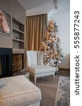 the chair by the fireplace with ...   Shutterstock . vector #555877243