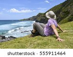 a female hiker in focus sitting ...