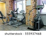 fitness bikes in a fitness hall | Shutterstock . vector #555937468