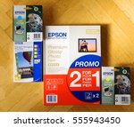 Small photo of LONDON, UNITED KINGDOM - NOVEMBER 5, 2015: Set of new Epson Claria ink-jet printer paint pack and Epson Glossy paper with Epson Semigloss photoaper