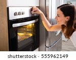 young happy woman roasting... | Shutterstock . vector #555962149