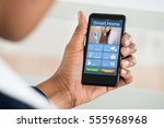 close up of person using smart... | Shutterstock . vector #555968968