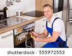 happy young male technician... | Shutterstock . vector #555972553