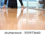 midsection of a businessman... | Shutterstock . vector #555973660