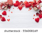 Stock photo wooden white background with red hearts gifts and candles the concept of valentine day 556008169