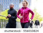multi ethnic couple jogging in... | Shutterstock . vector #556010824