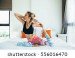 woman doing yoga exercise on... | Shutterstock . vector #556016470