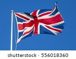 a shot of the union flag flying ... | Shutterstock . vector #556018360