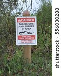 Small photo of Danger, alligator and snakes in the area warning sign