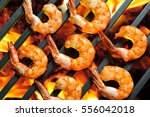 grilled shrimps prawns on the... | Shutterstock . vector #556042018