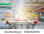 supermarket aisle with empty... | Shutterstock . vector #556046554