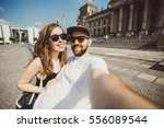nice couple of students taking... | Shutterstock . vector #556089544