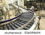 crossing of the roller conveyor | Shutterstock . vector #556098694