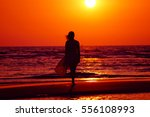 Woman Walk On The Beach On The...