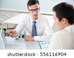young businessmen discussing a... | Shutterstock . vector #556116904