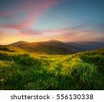 mountain valley during sunrise. ... | Shutterstock . vector #556130338