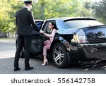 Chauffeur Opening Car Door For...