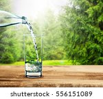 pouring clear water into glass... | Shutterstock . vector #556151089