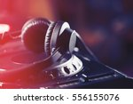 party dj headphones on cd... | Shutterstock . vector #556155076