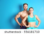 sporty young couple on color... | Shutterstock . vector #556181710