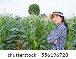 Asian Woman Farmer With Panama...