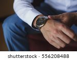 businessman checking time from... | Shutterstock . vector #556208488