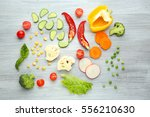 fresh vegetables on wooden... | Shutterstock . vector #556210630