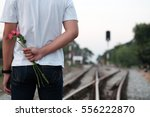Young Casual Man Holding...